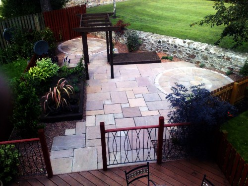 Decking, balustrade and stone patio.