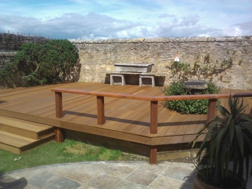 Hardwood timber decking with stone troughbarbecue.